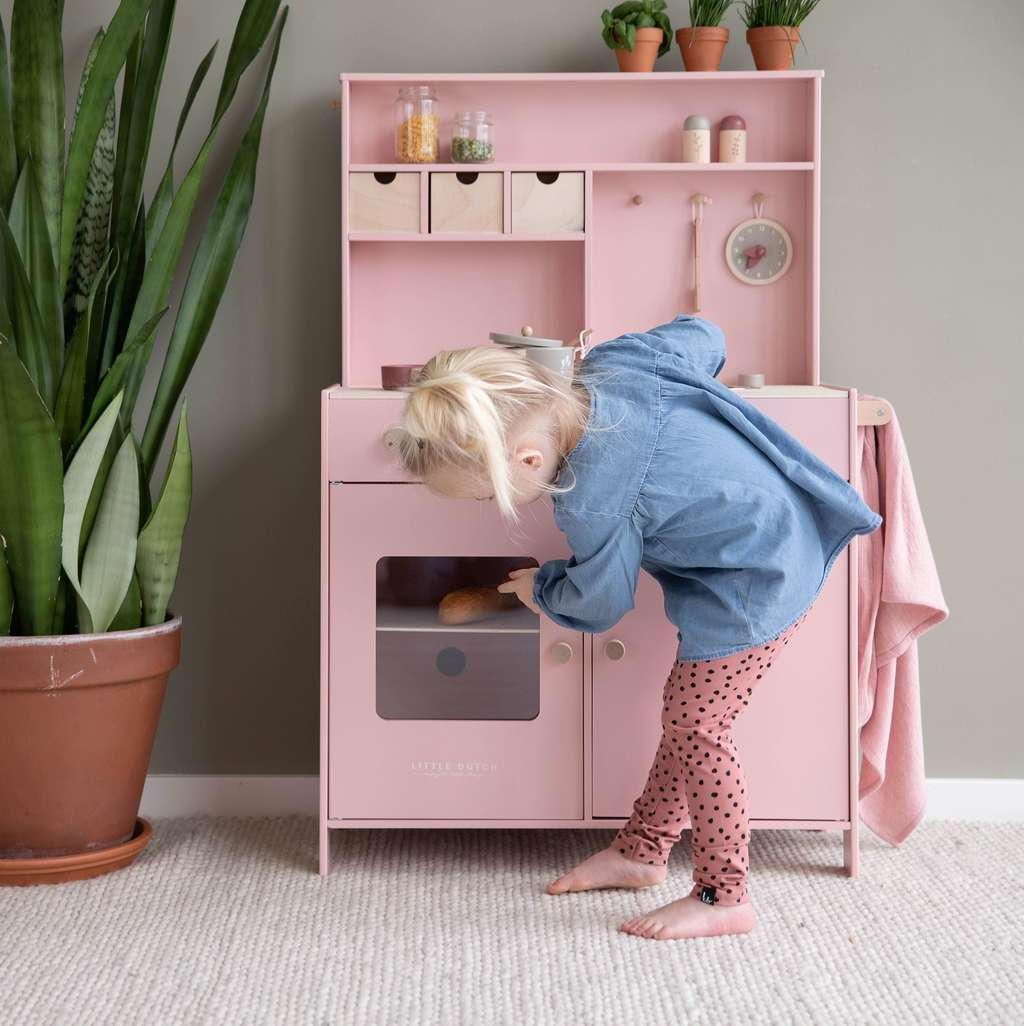 PINK WOODEN KITCHEN WITH TOOLS