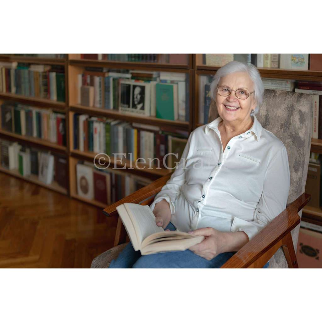 Senior woman sitting with a book