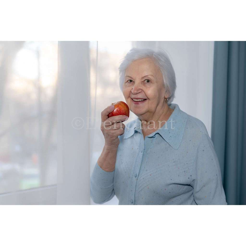 Senior  woman is going to eat an apple