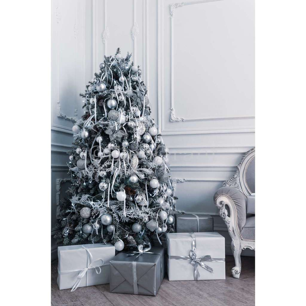 Modern decorated Christmas tree in white and silver colors with gift boxes