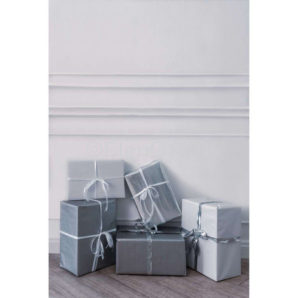 Christmas gift boxes in front of white wall