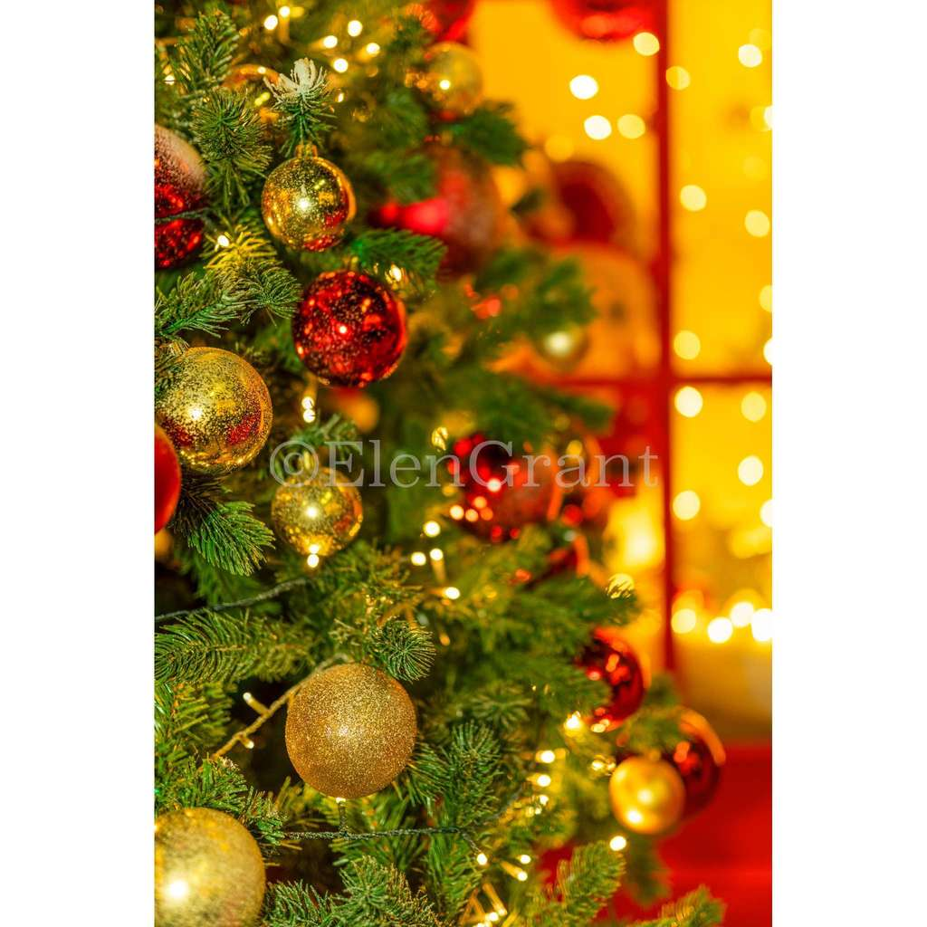 Christmas tree decorated red and gold balls