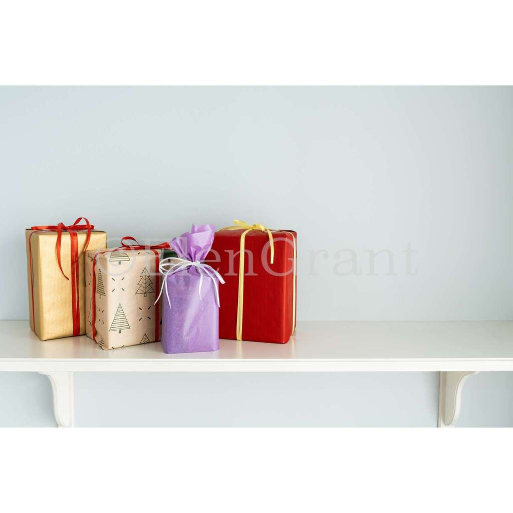Christmas colourful gift boxes on the white shelf