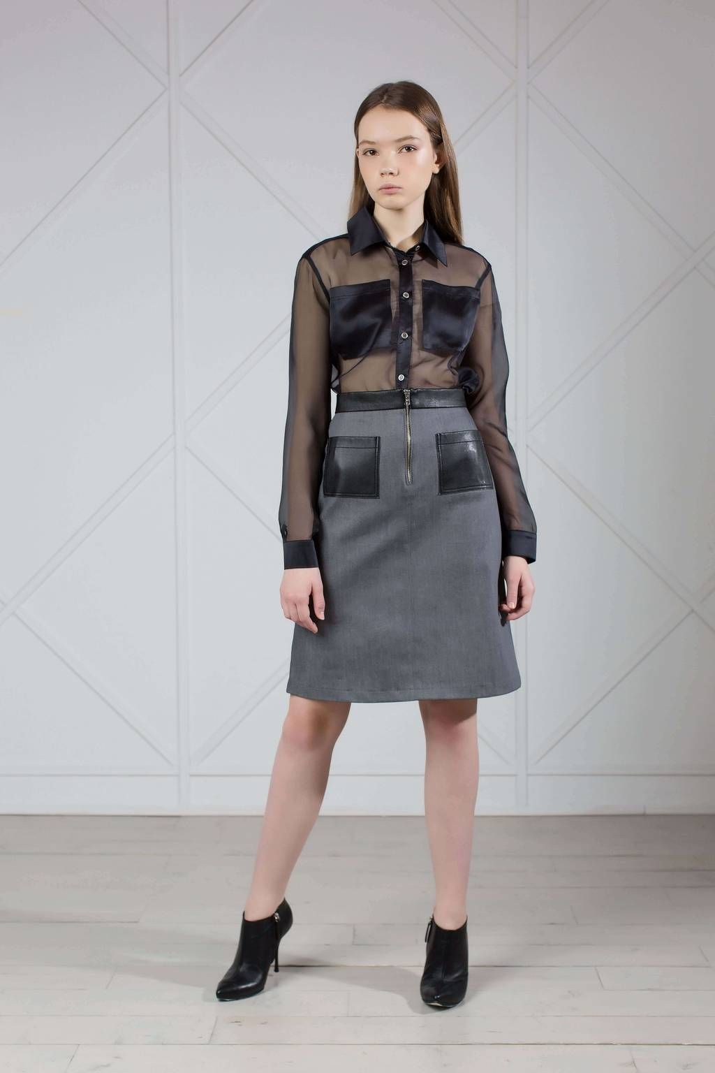 Gray denim A-line skirt with leather