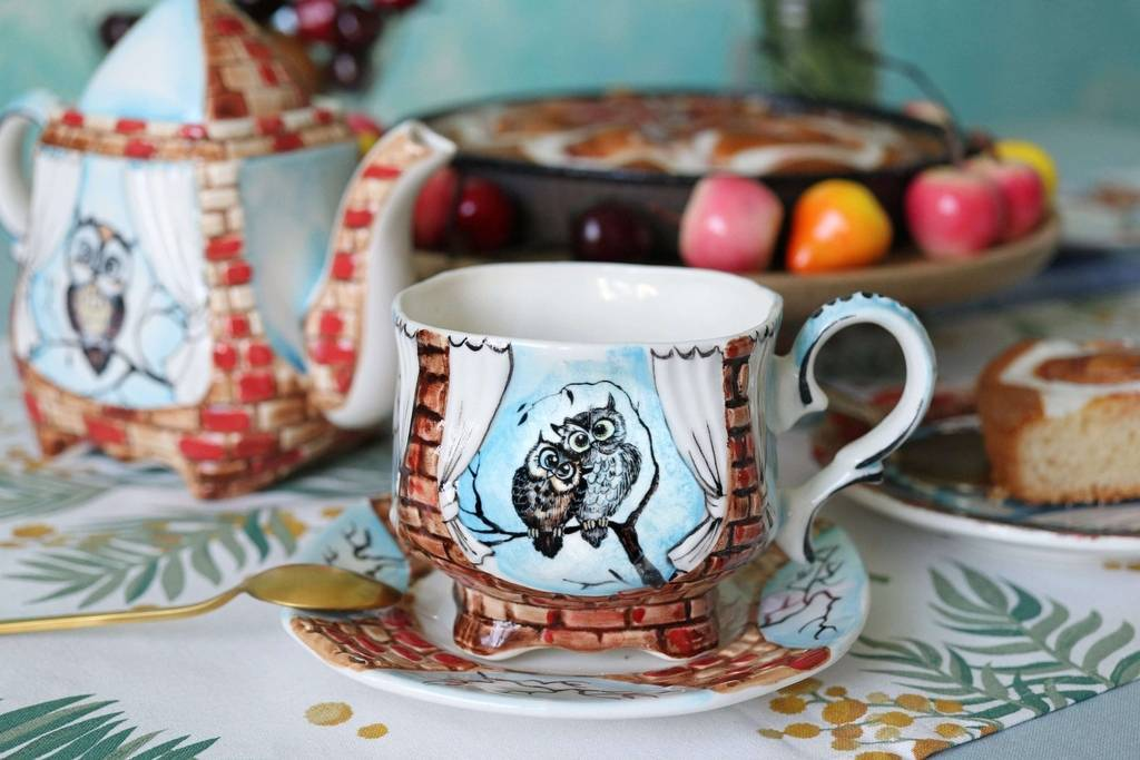 Handmade porcelain tea cup and saucer Two owls