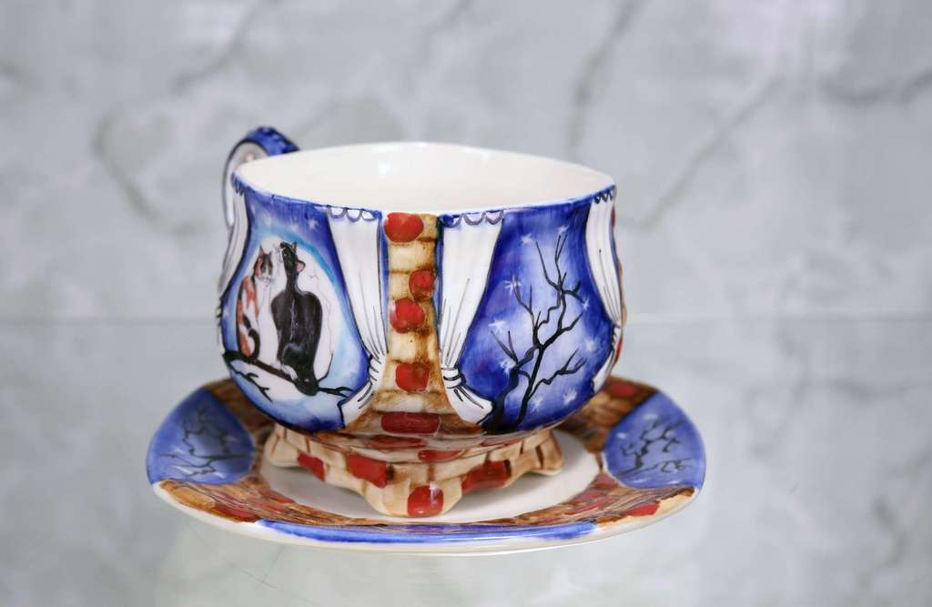 "Handmade porcelain tea cup and saucer ""Cats on a branch"""