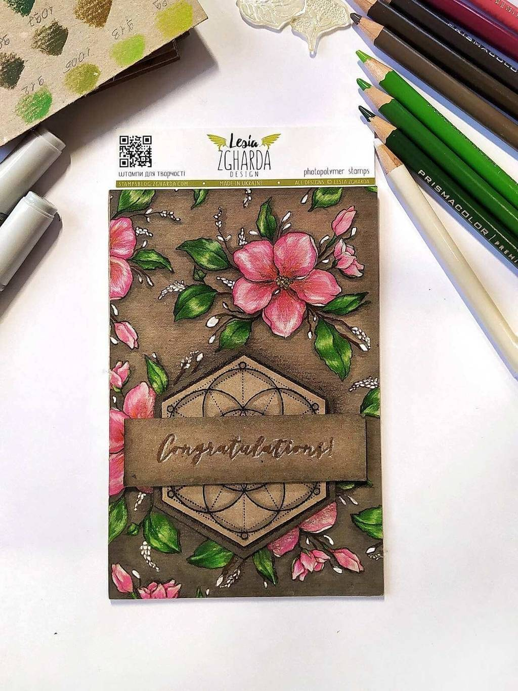 Image - Using the congratulation sentiment stamp on stamped card and shading with pencils by Lesia Zgharda clear stamps.