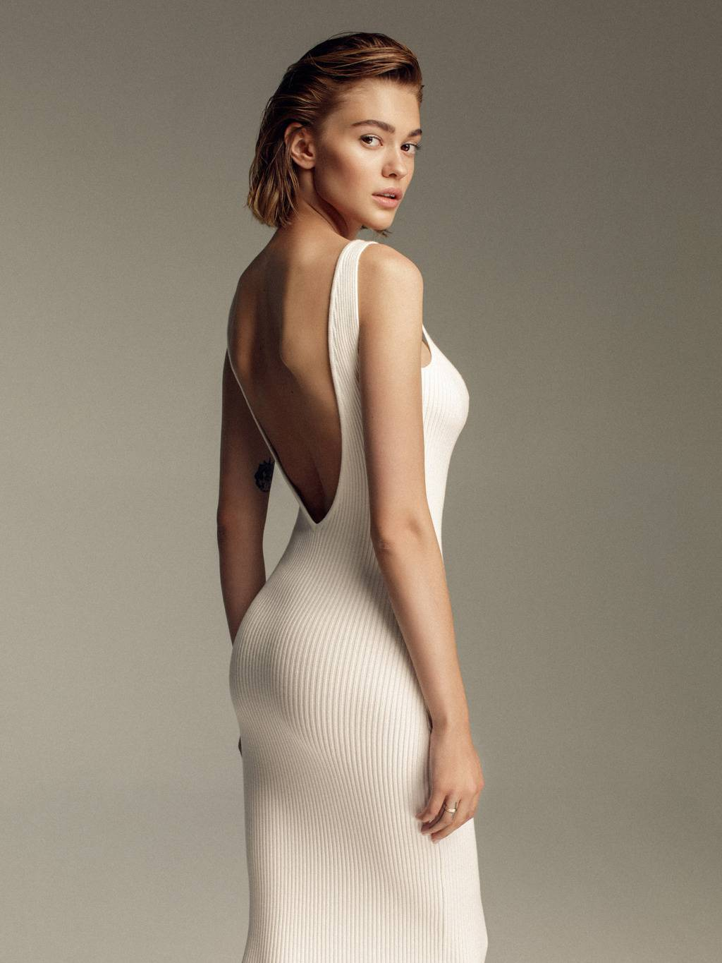 Ribbed knit dress with open back - 287 USD / 246 EUR