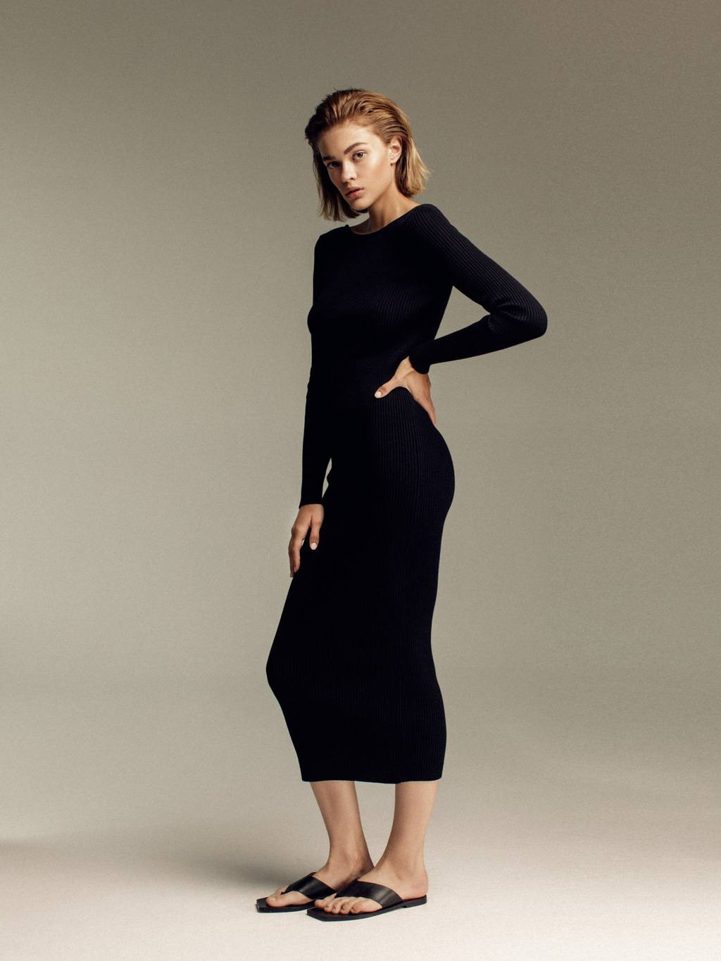 Ribbed knit dress with chain - 356 USD / 306 EUR