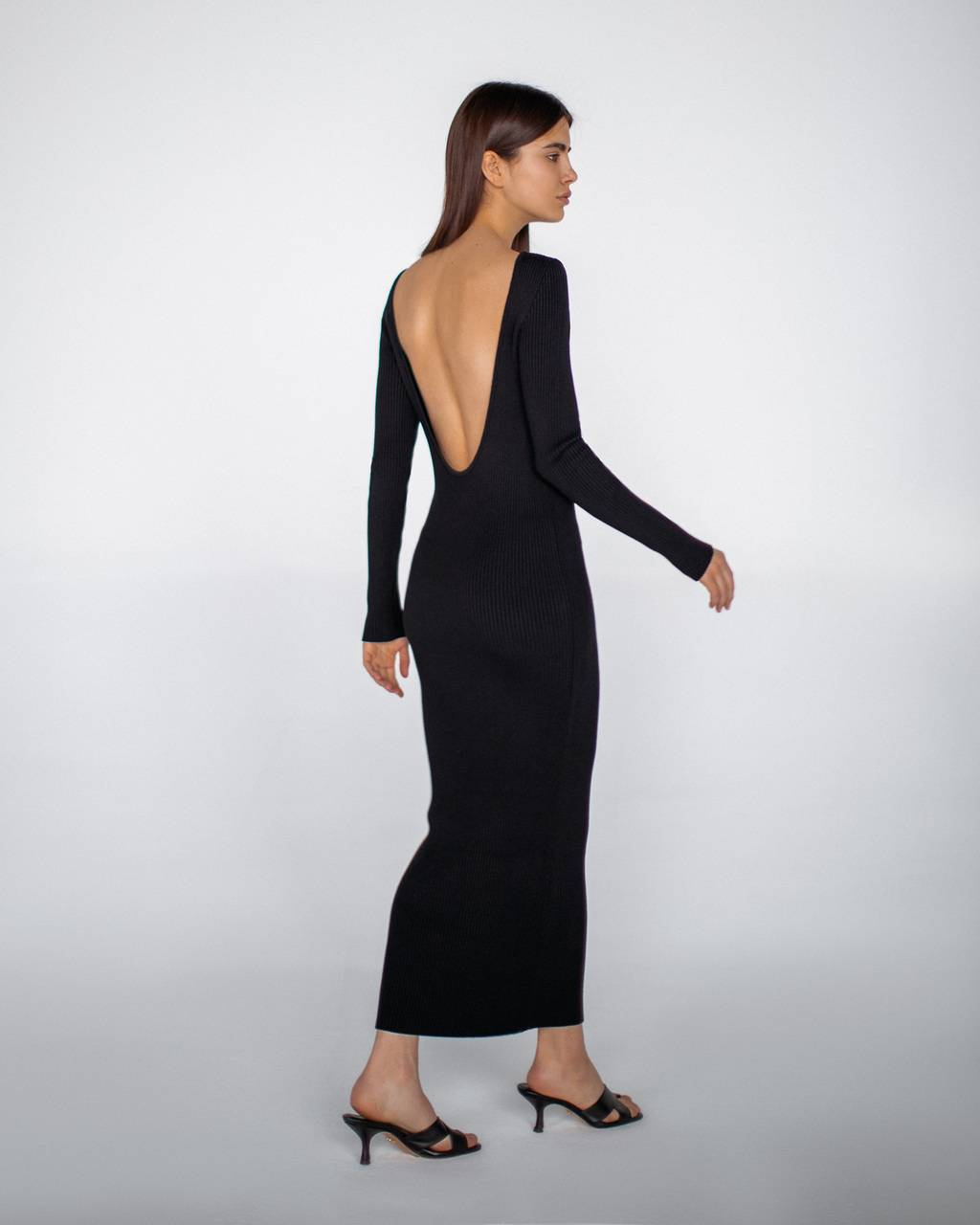 Knit dress with open back - 292 USD / 249 EUR